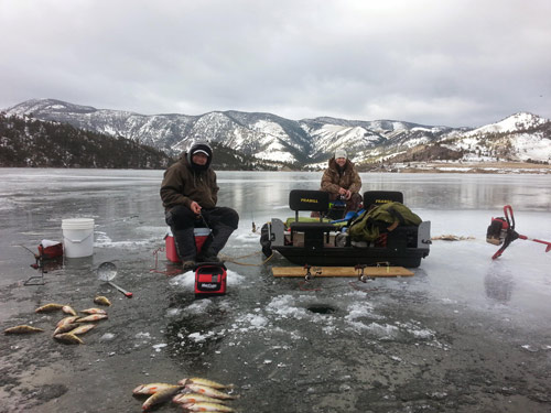 Two friends ice fishing