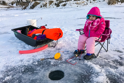 Young girl ice fishing