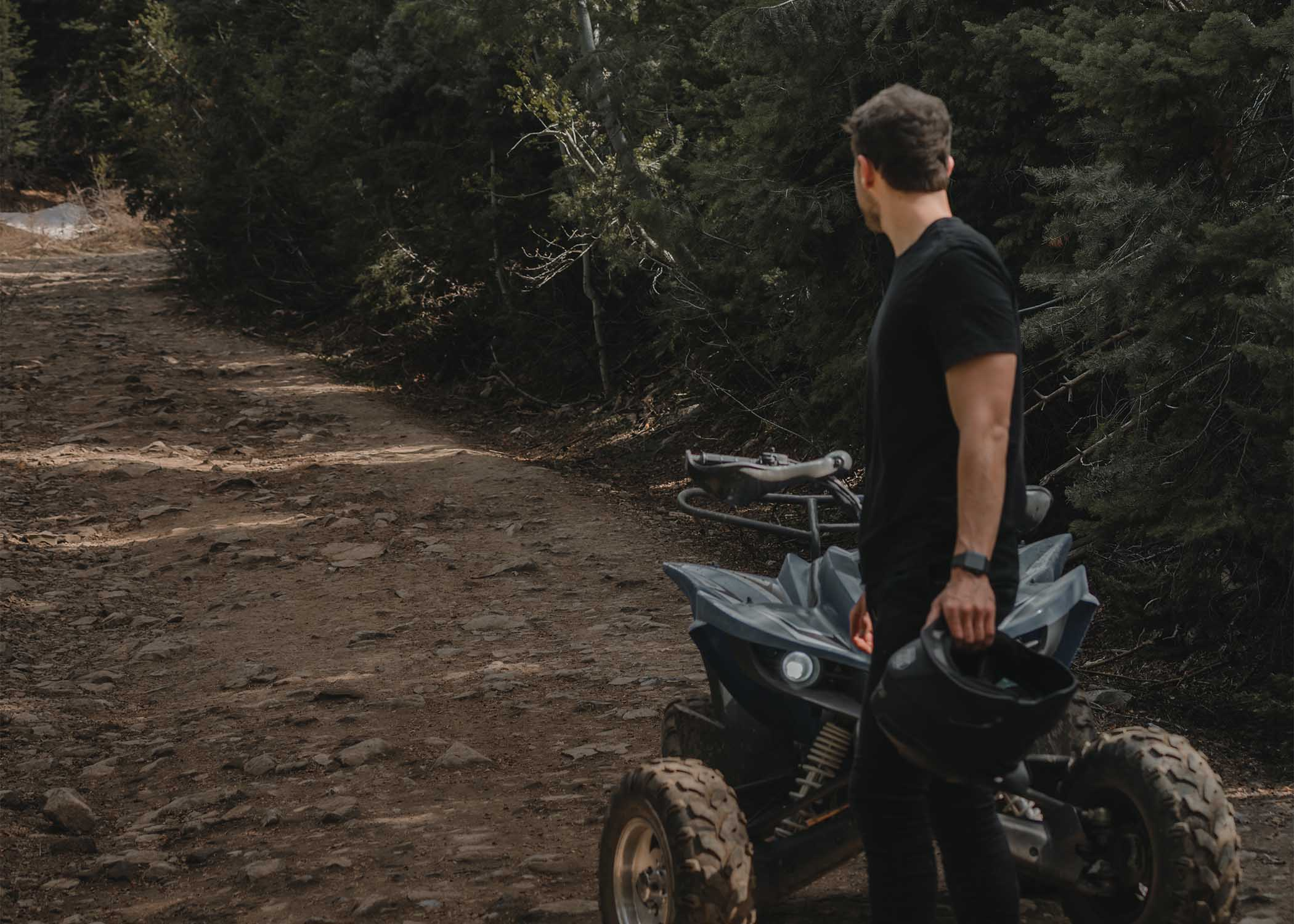 ATV rider looking back on a dirt road
