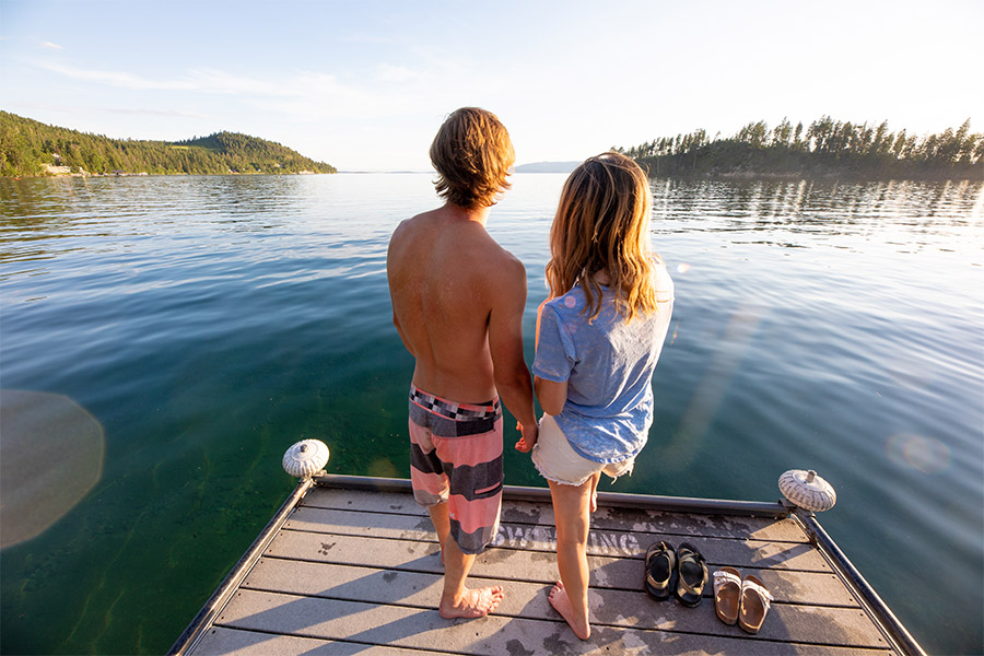 Couple on the dock at Flathead Lake State Park - Yellow Bay